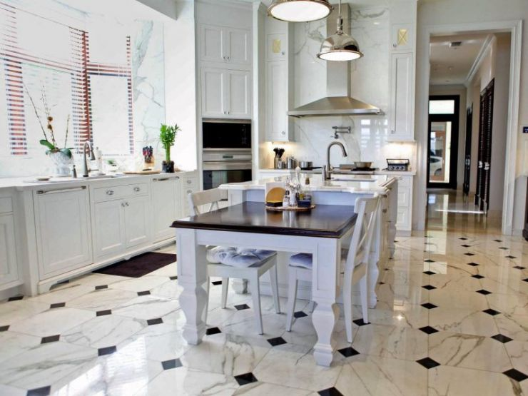 marble-flooring-for-cozy-kitchen-decor-with-white-cabinet-and-drawers-also-using-round-aluminium-lights-above-small-island