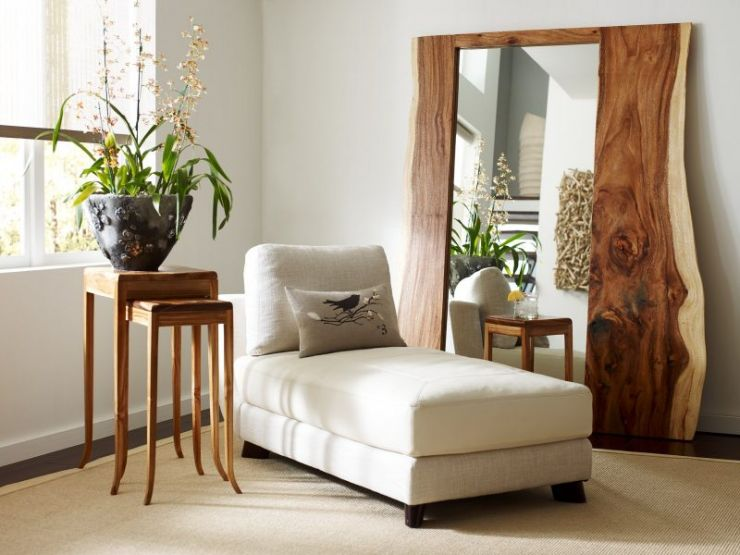 comfortable-lazy-chair-colored-in-white-created-beside-large-wall-mirrors-and-wooden-side-table