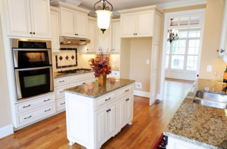 brilliant-paint-kitchen-cabinets-for-cozy-kitchen-with-white-island-and-brown-granite-countertop